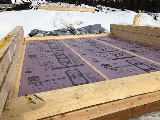 Rigid-foam-insulation-sits-directly-beneath-the-floor.