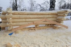 Logs-with-ends-labeled.-Also-included-is-the-jig-used-to-line-up-the-roof-logs.