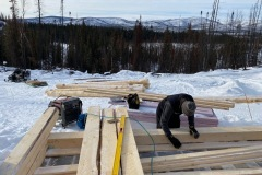 Setting-up-the-sill-logs-on-the-foundation.